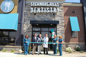 Nicholas Rorick, D. D. S.. cuts the ribbon at the opening ceremony for Sycamore Hills Dentistry.