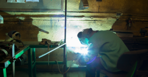 person welding in a workshop