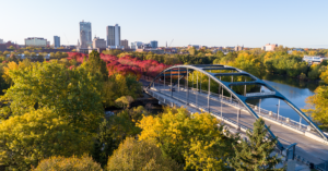 the martin luther king jr bridge leading to downtown fort wayne with fall foliage lining Clinton Street