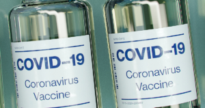 containers of covid-19 vaccines