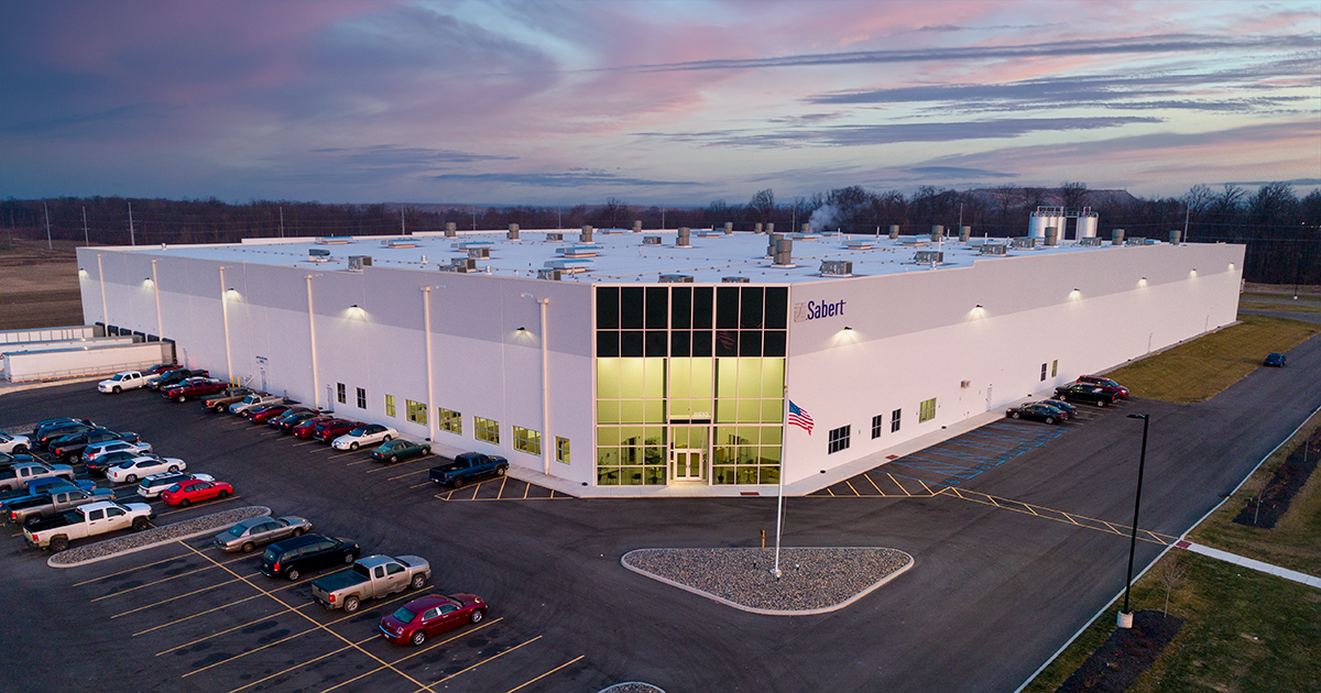 exterior photo of sabert research and development center at sunrise