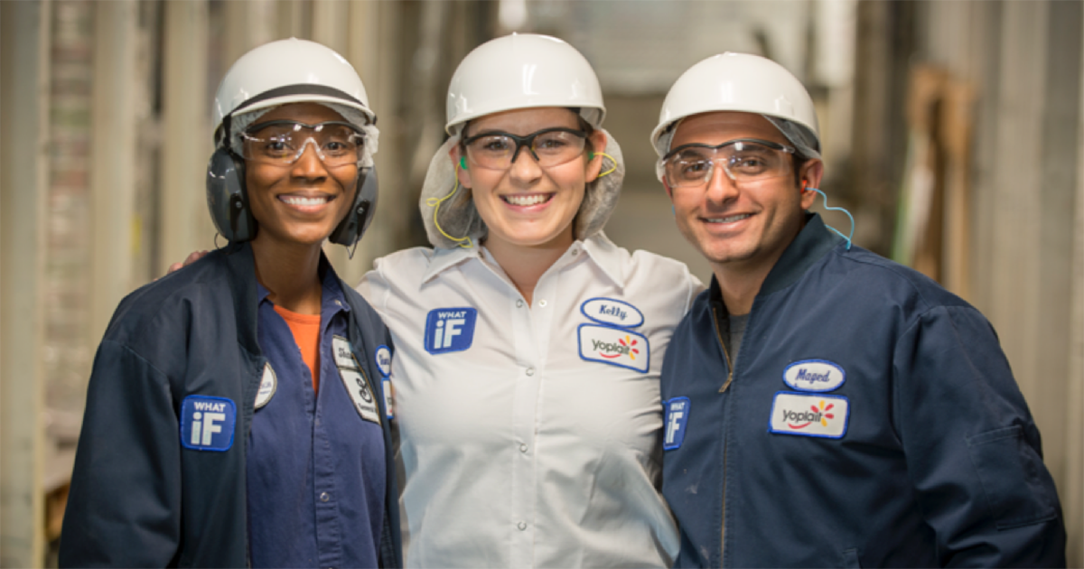 three general mills employees in hard hats and safety glasses