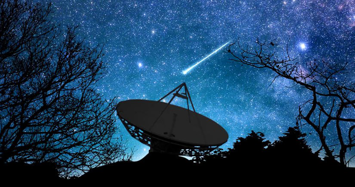 satellite dish pointed skyward at night