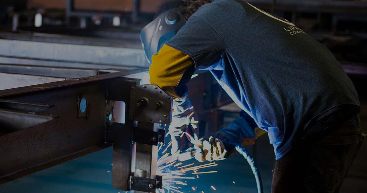 employee welding metal parts