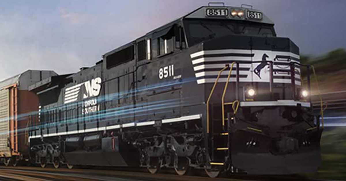 norfolk southern locomotive moving down a train track