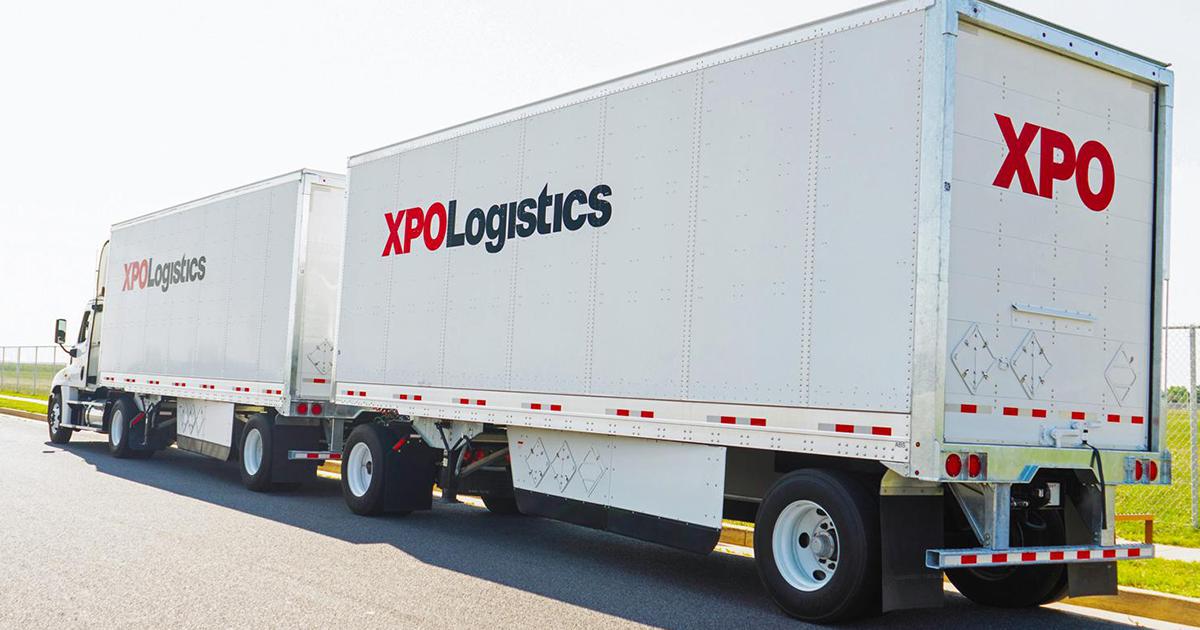 semi truck pulling two XPO Logistics trailers